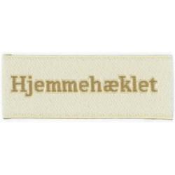 """Label """"hjemmehæklet"""" 5 x 2 cm i beige"""