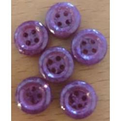 Små lilla knapper i plastik. Pose med 8 stk. 10mm